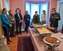 Faculty and students gather as Dennis Banks blesses a meal