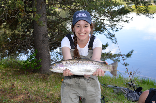 Arielle Sperling holds up a live fish