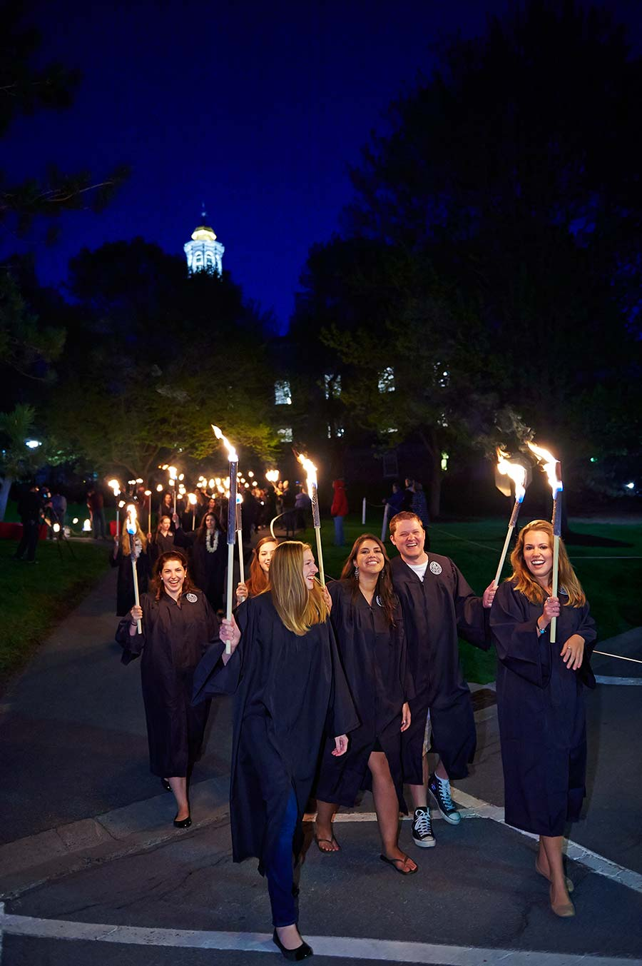 Graduating seniors walk down the hill during the torchlight processional