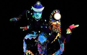 Deep Blue Show featuring colorful costumes and performing dancers.