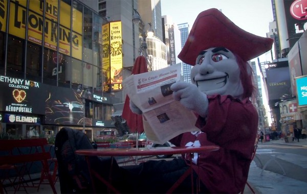 Raider reading the Maroon News in Times Square