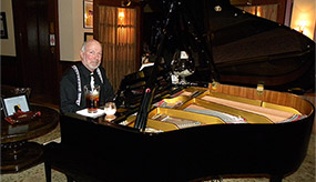 Arthur G. Pitts playing piano