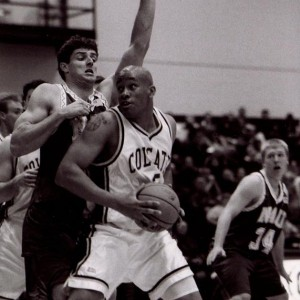 Howard Blue driving on the basket during a game in his Colgate Basketball career