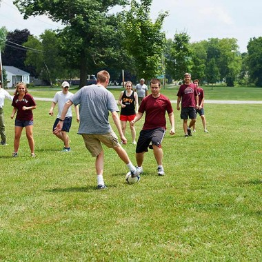 Faculty and students play soccer