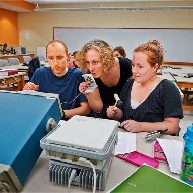 Professor Beth Parks works with students in a frequencies lab