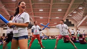 Students joust with foam swords in Sanford Fieldhouse