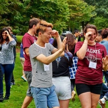 Students look through their hands during an ice breaking activity