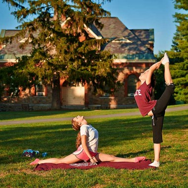 Students practicing yoga on the academic quad