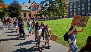 Students march on the quad to end a peaceful sit-in protest.