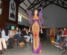 Student in butterfly-inspired purple dress
