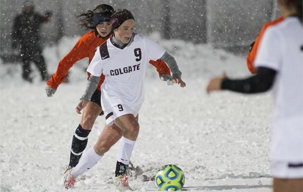 Caroline Brawner '15 playing soccer in snowstorm