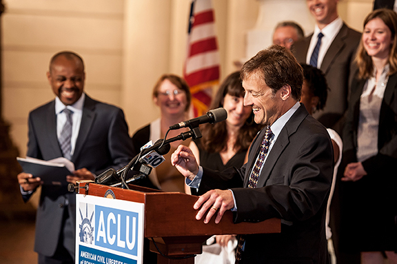 Walczak speaking at an ACLU podium