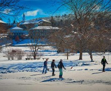 Students play hockey on a frozen Taylor Lake