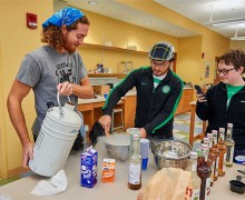 Students make ice cream in a laboratory