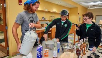 Students make ice cream in a laboratory