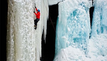 Students ice climbing at Tinker Falls.
