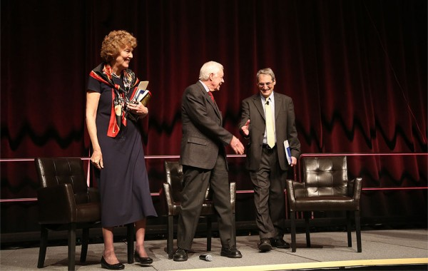 Steven Kepnes shaking hands with President Jimmy Carter on stage
