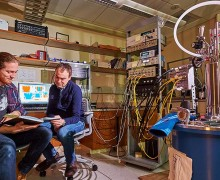Segall and his student Matt LeGro '15 sit near helium condensing equipment