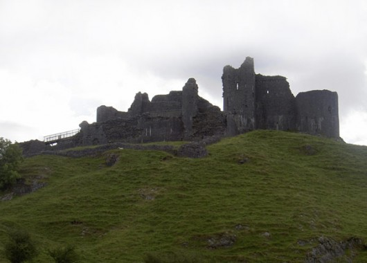 The ruins of Carreg Cennen castle atop a hill