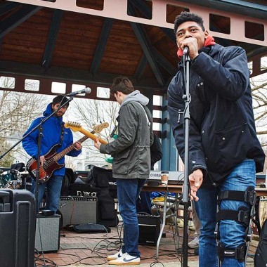 Students give musical performance on the Hamilton Village Green