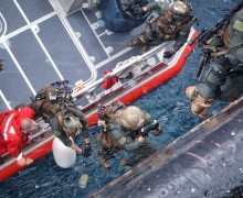 Marines climbing from watercraft