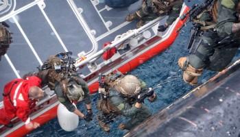 Marines climbing from watercraft