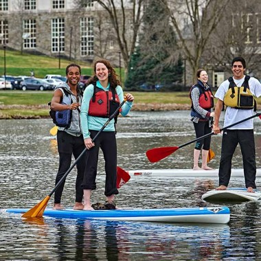 Students stand-up paddle boarding on Taylor Lake
