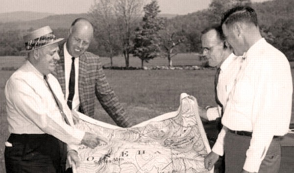 Robert Trent Jones and others review plans for the course