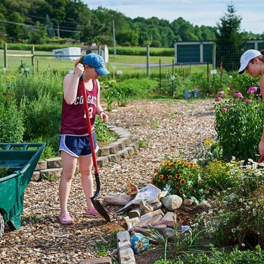 Students work in the community garden