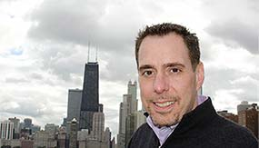 Jeffrey Sumber '92 with Chicago's skyline behind him