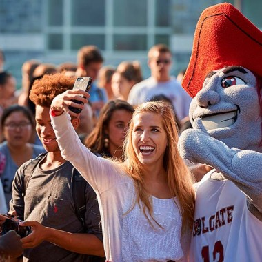 Student snaps a selfie with Raider.