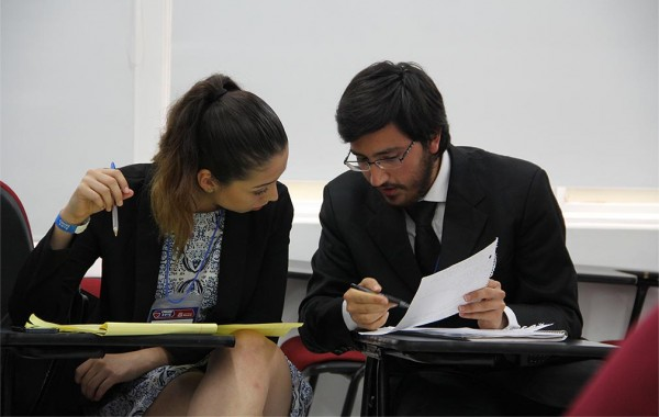 Valeria Felix '18 and Federico Elizondo '17 prepare before a debate