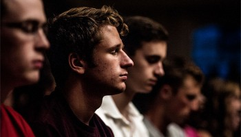 Faces of students listening attentively