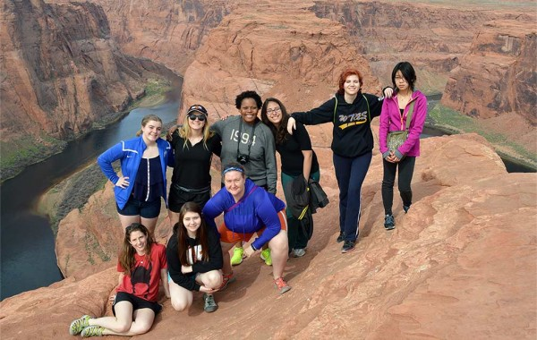 Kelda Olson Hutson (front, far right) took her daughter (on her right) and other high schoolers hiking. They're pictured above the Colorado River in Arizona.