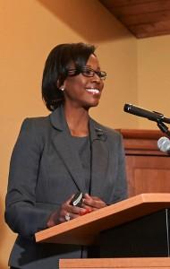 Professor Nina Moore at a podium