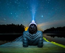 Kaitlin Abrams '18 in the Thousand Islands gazing at the stars while wearing a headlamp