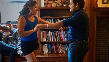 Students and parents dancing in La Casa