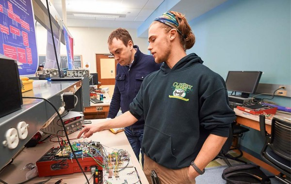 Professor Ken Segall looks on during an electronics project demonstration in the Ho Science Center