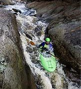 Student kayaks through rapids
