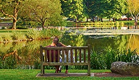 Colgate couple on bench by Taylor Lake