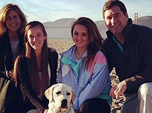 Susan Blick '15 with her family and dog in front of the Golden Gate Bridge