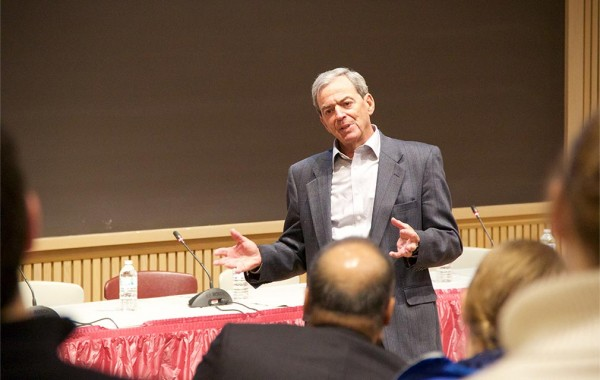 Dr. Michael Wolk '60 talks with students about the challenges facing the American health care system.