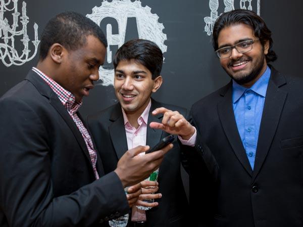 Jimmy Anim '19 speaks with Rohan Chaudhari '19 and Araven Tiroumalechetty '19