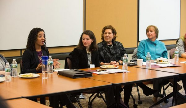 Women in Law participants speak at a gathering on campus