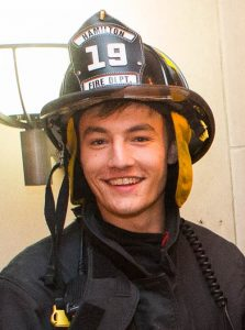 Adam Pratt in firefighting gear