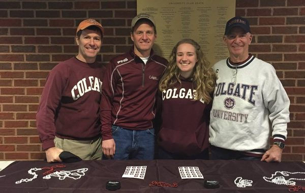 Three Colgate generations pictured in Colgate gear