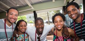 Five alumni smile for a photo in ALANA during Reunion 2016