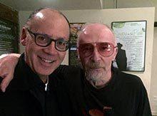 Greg Brodsky '79 with recording artist Graham Parker