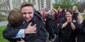 Nathan Fritz '16 embraces his friend Justin Loscalzo '16 while their other mates from first year applaud