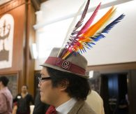 Karl Louis Uy '16 sports a Colgate fedora with six colorful feathers